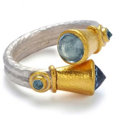 Aquamarine Crossover Ring 5126 Silver and gold crossover ring with faceted aquamarine. Poppy Dandiya