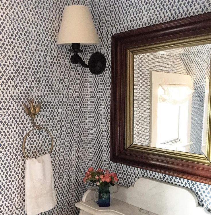 Charming powder room with Sister Parish Burmese Blue wallpaper - via James Showroom