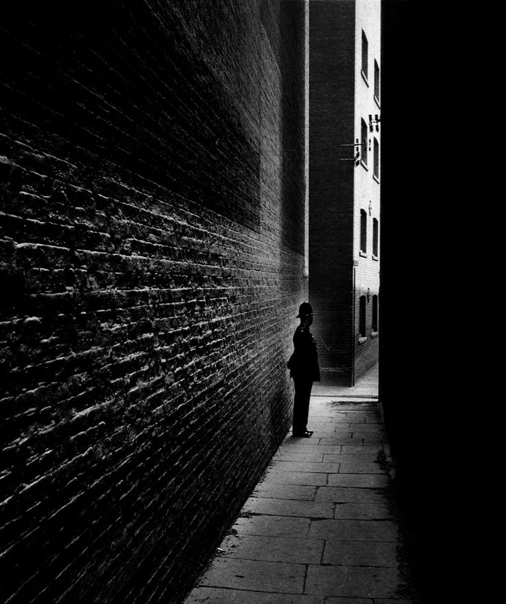 """Policeman in a Bermondsey Alley"" - London - 1938 - photographer Bill Brandt."