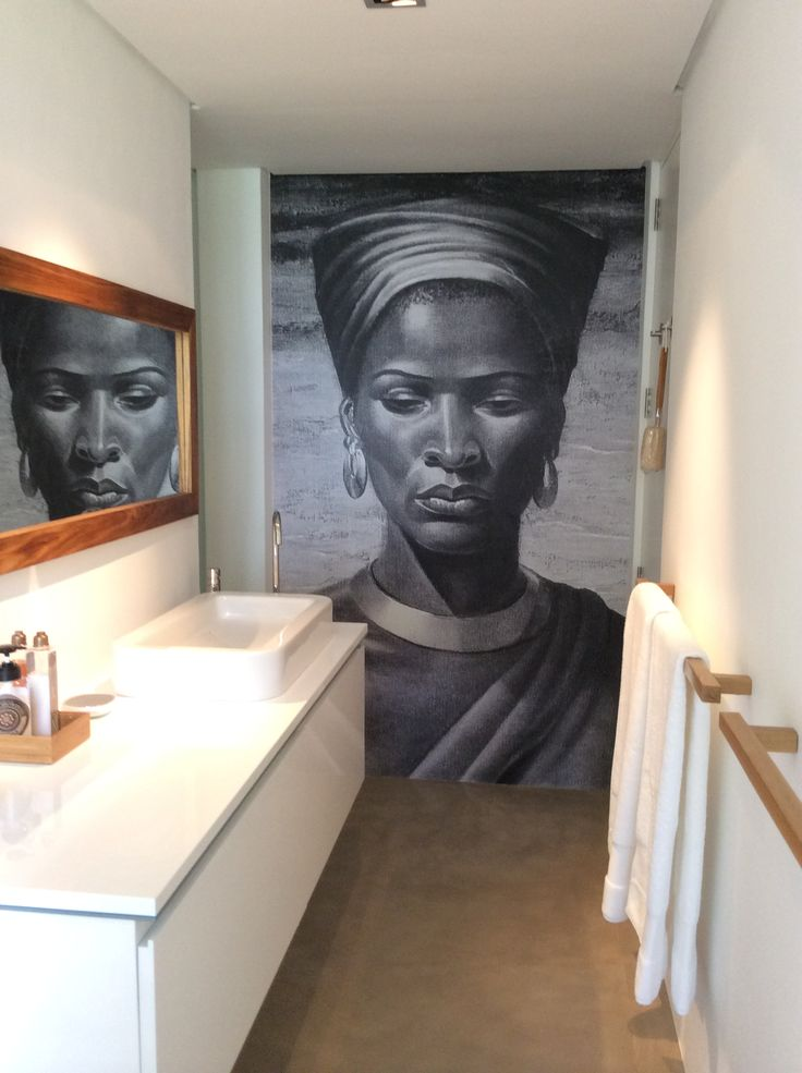 The grey scale Tretchikoff wallpaper creates a luxurious finish to this bathroom.