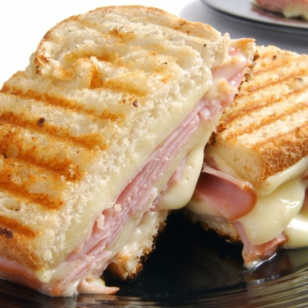 Perfect Ham and Swiss Panini  2 tablespoons unsalted butter 1/8 cup spicy Dijon mustard 1/8 cup mayo 8 slices rustic white bread, 8 slices Swiss cheese 8 slices cooked ha...