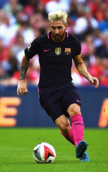 Lionel Messi of Barcelona in action during the International Champions Cup match between Liverpool and Barcelona at Wembley…
