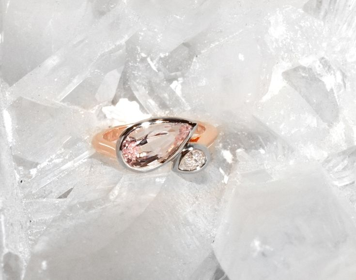 Inspired by Botticelli's The Birth of Venus, the Venus engagement ring by Lizunova Fine Jewels is handcrafted in 18k rose & white gold and set with a pastel pink morganite, dubbed 'the love stone', and a sparkling diamond. The two stones are seemingly entwined in an affectionate embrace, symbolising two people coming together in a relationship.