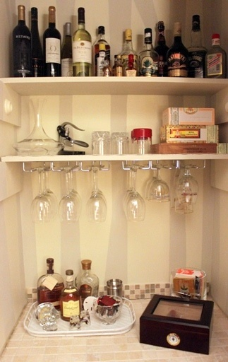 Turning a living room closet into a bar.  Totally doing this.