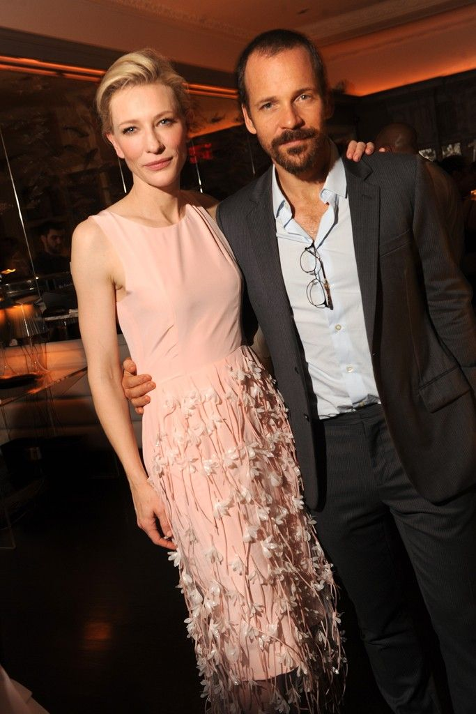 Cate Blanchett in Balenciaga and Van Cleef & Arpels with Peter Sarsgaard in Dior Homme and Emporio Armani at MoMA.