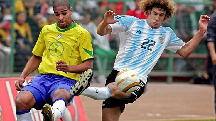 Argentina 2 Brazil 2 (2-4 p) in 2004 in Lima. Adriano gets a flick on the ball with Fabricio Coloccini closing in at the Copa America Final.
