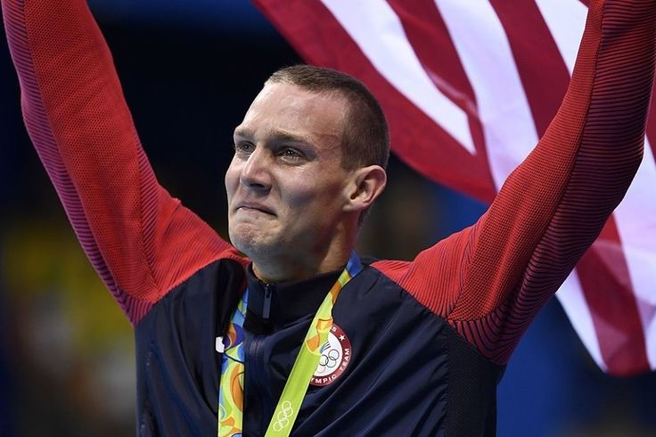 Caeleb Dressel is taking the moment in. | 24 Photos Of Olympians Achieving Their Dreams That Will Make You Emotional
