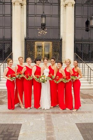 One shoulder red bridesmaids dresses not in love with that dress but the long red dresses make me so happy!!!