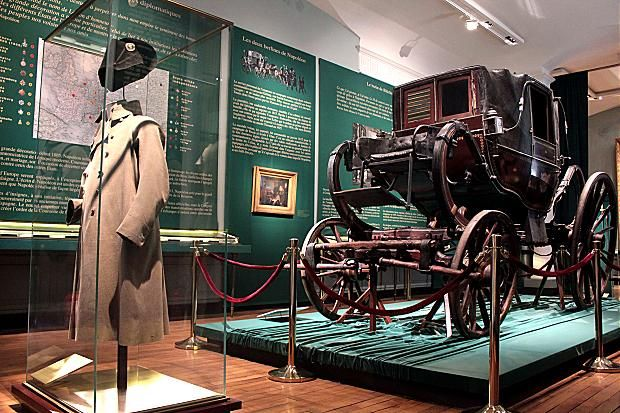 Napoleon's overcoat, bicorne hat, and carriage, captured by Prussian troops on the eve of the Battle of Waterloo at the Musée de la Légion d'Honneur in Paris,  This carriage is said to have been used by Napoleon to freshen up and sleep between battles.