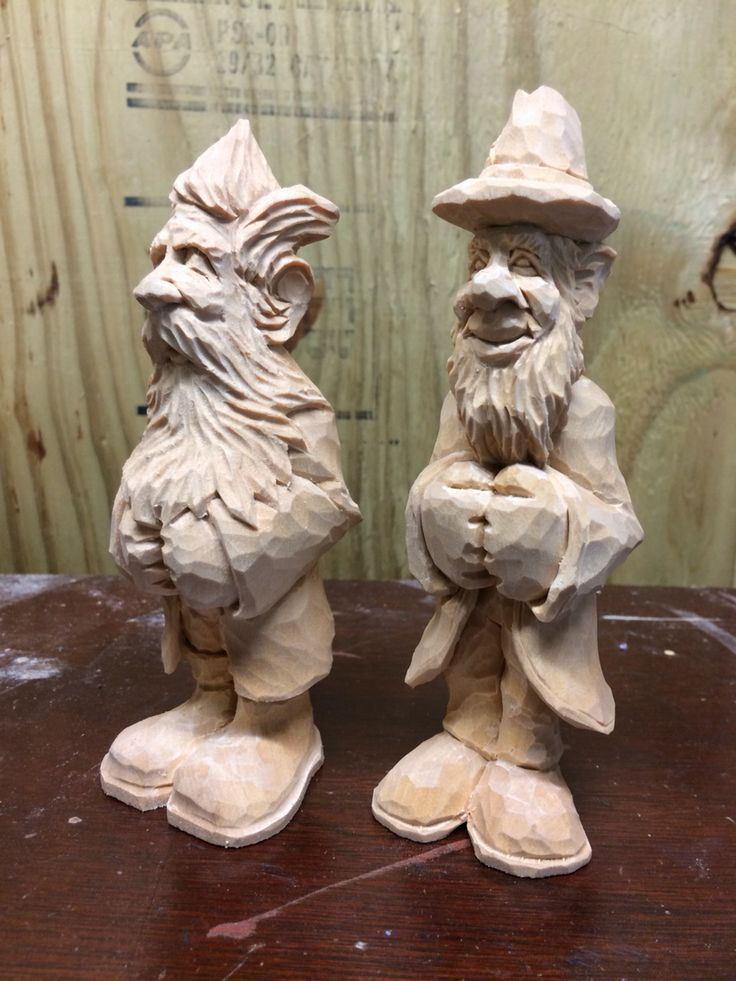 Caricature wood carving sleepy dwarf and leprechaun by