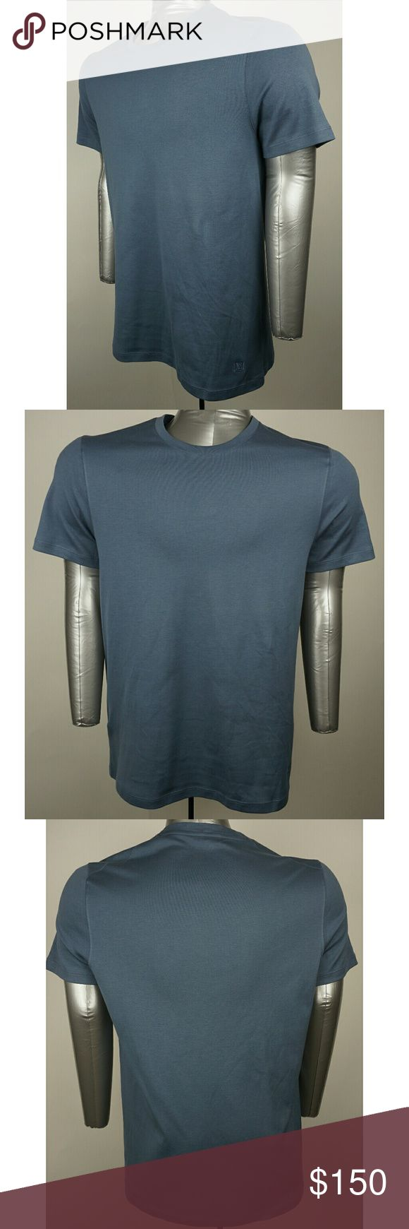 """Men's Louis Vuitton T-Shirt Short sleeve t-shirt with embroided LV. Luxurious blue color.  Worn 1 time and is in excellent condition.  -Sizing: *please measure your clothing to compare fit as sizing varies between designers and even identical garmets*. -Chest      - 20""""   (armpit to armpit across chest) -Shoulder- 17""""    (Straight across shoulders seam to seam) -Back       - 27.5""""  (Neck seam to bottom of shirt-excludes collar) -Sleeves  - 9""""  (Shoulder seam to end of cuff) -Material: 100%…"""