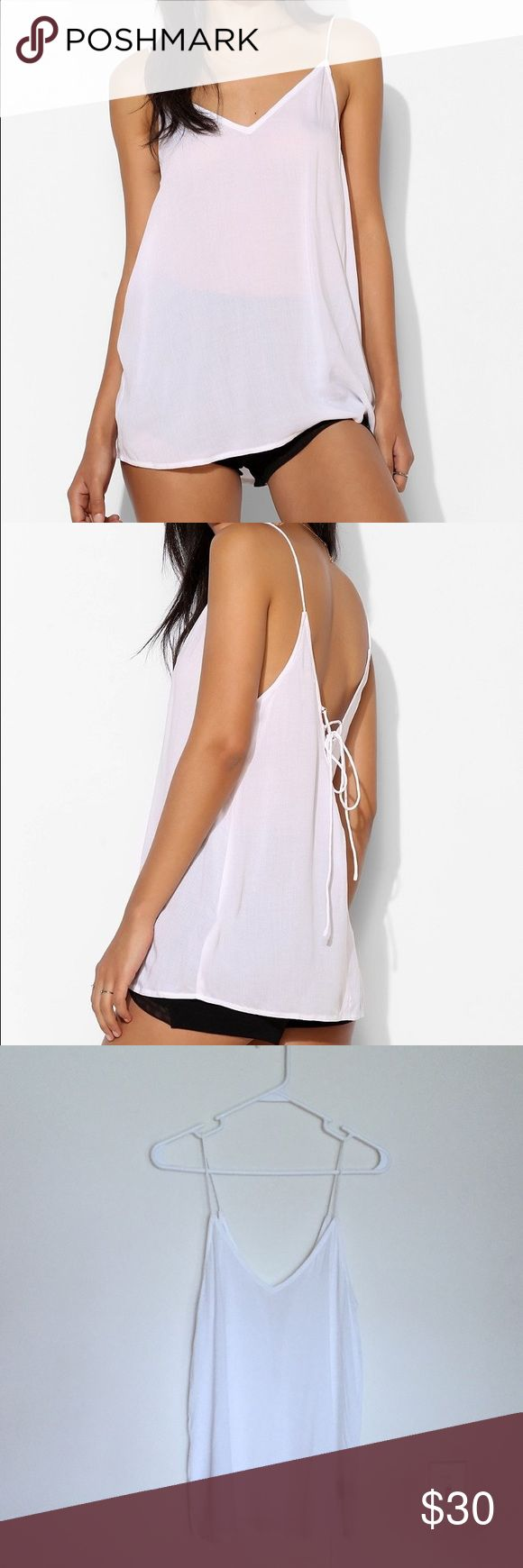 Urban Outfitters Silence+Noise Drapey Lace Up Cami Airy, super soft woven tank top with subtle stripe texture, with a lace-up, deep V-back with burnish metal eyelets. Cut in a drapey silhouette with skinny straps. Semi sheer. Feminie scoup neckline. Shirttail hem. Like new, worn lightly once. Urban Outfitters Tops Tank Tops