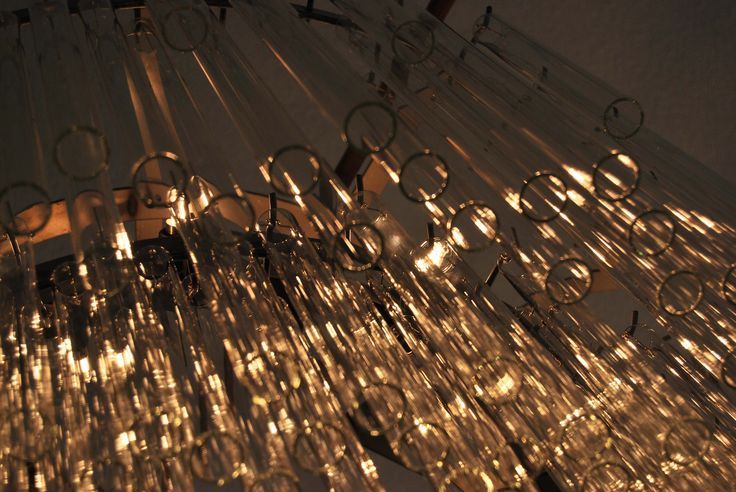 LAMPADARIO DONUTS / DONUTS CHANDELIER sizes 97 X 97 X 50 Donuts Chandelier made with steel frame and glass tubes. Equipped with black iron ceiling rose. Orvett Design