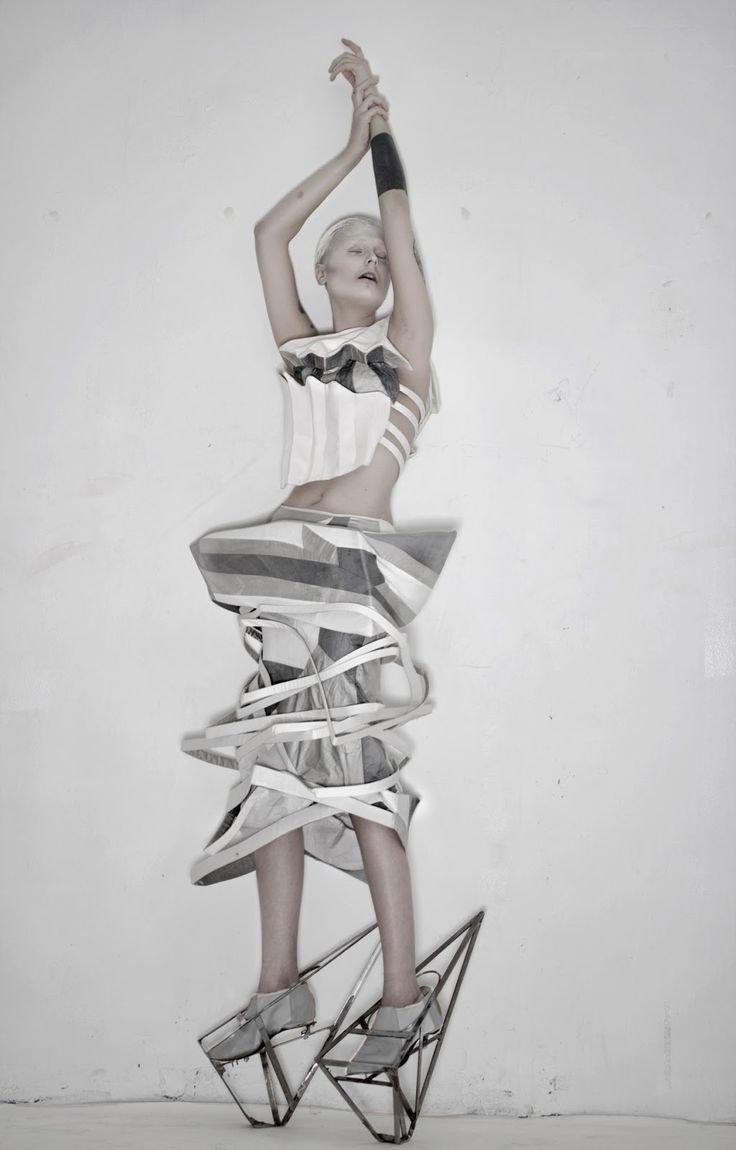 Fashion as Art - sculptural fashion with strong geometric lines, using fabric manipulation to create 3D shapes & dramatic structure; Michele Castellano