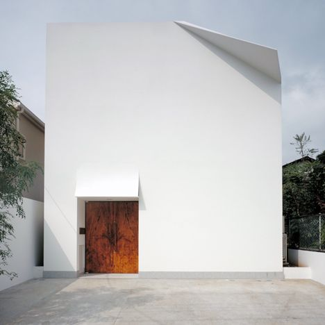 Japanese house featuring a wall that appears to have been folded down like a piece of paper.