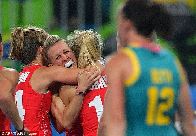 Alex Danson is congratulated by her Great Britain team-mates after scoring against Australia