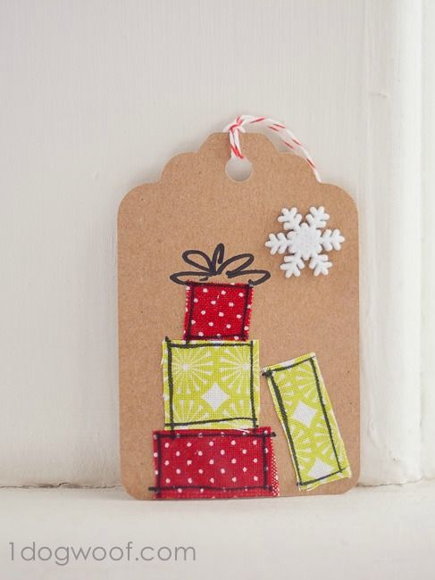 Love this super simple idea for DIY Christmas gift tags ... fabric scraps and a sharpie!!