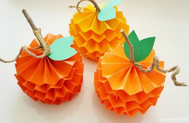 My step by step photo tutorial for how to make paper pumpkins for fall. Cute for table top or mantel decorations.