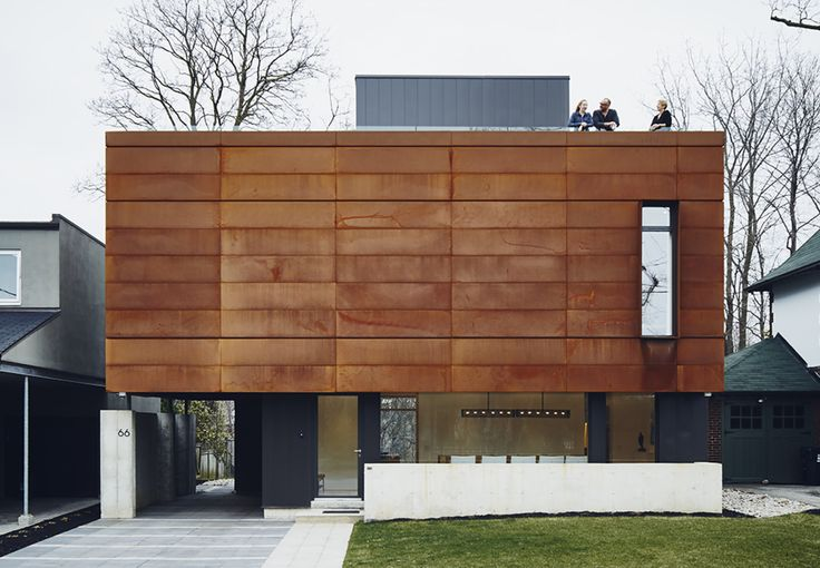 The front facade features Cor-Ten steel fabricated by Praxy Cladding.