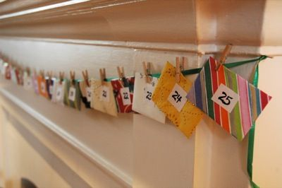 Hang a string of small patterned envelopes on your mantel and fill them with family activities for each day of December.