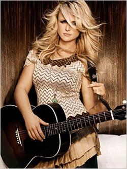 Blonde American country music artists Miranda Lambert with her guitar