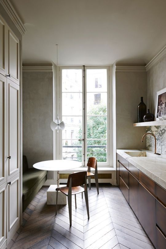 These are the most popular kitchens in Vogue Living - Vogue Living  |  This Paris galley kitchen designed by Joseph Dirand is easily one of the favourites of Vogue Living readers. And we can see why with the combination of diagonal parquetry floors, marble benches and an olive green banquette seat.