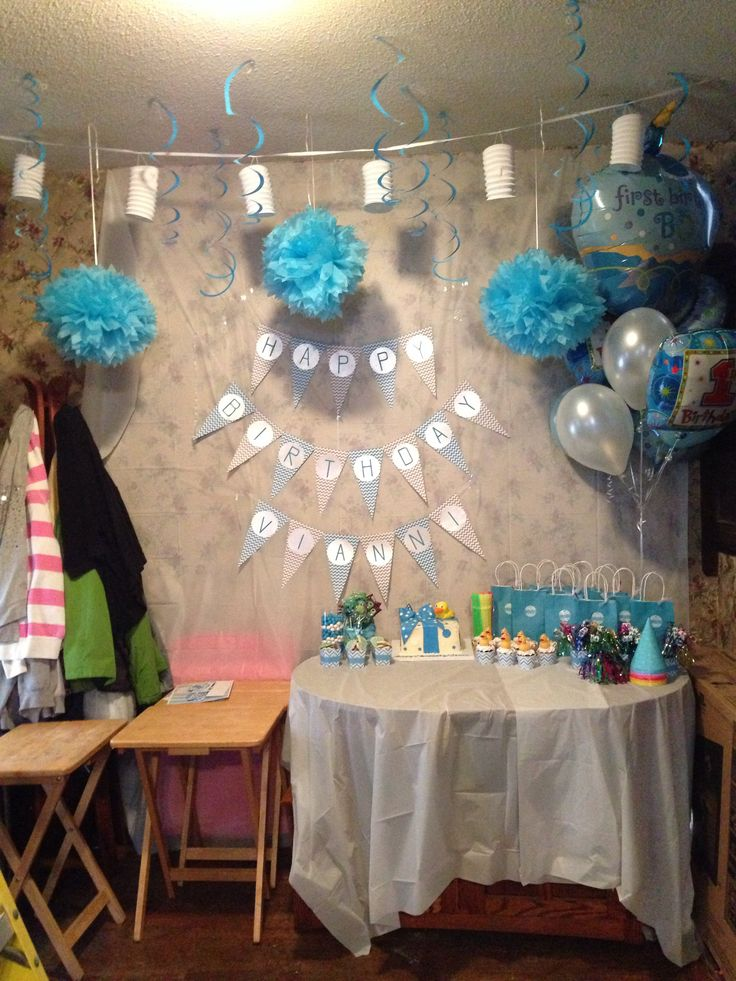 My sons first birthday party. We couldn't decide on a theme. We ended up throwing in chevron patterns, rubber ducky's and monsters inc together. All his favorite things.