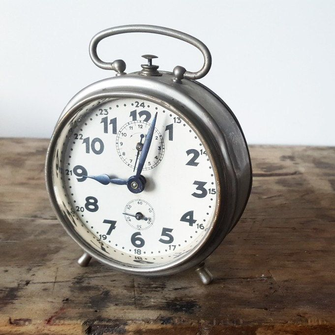 Lovely french alarm clock, from the first part of the last century. Beautiful detail interiour industrial or vintage inspired decoration.