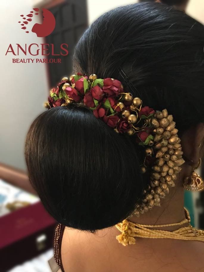 What A Beautiful Low Bun With Gajra Care However Should Be Taken Before Adopting Such Bridal Hair Decorations Bridal Hairstyle Indian Wedding Hairdo Wedding