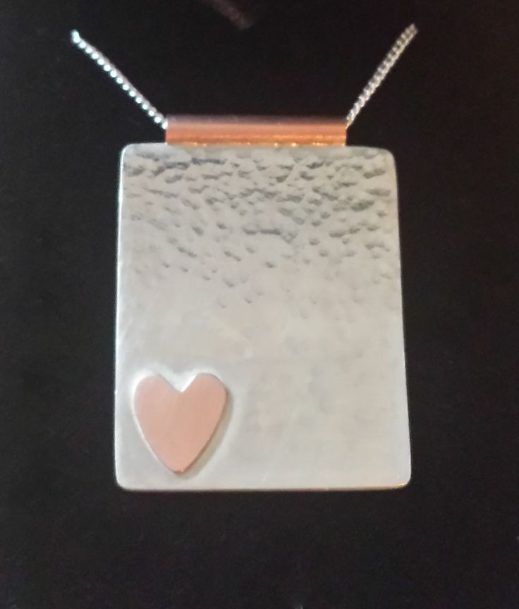 Silver and copper hammered pendant with heart