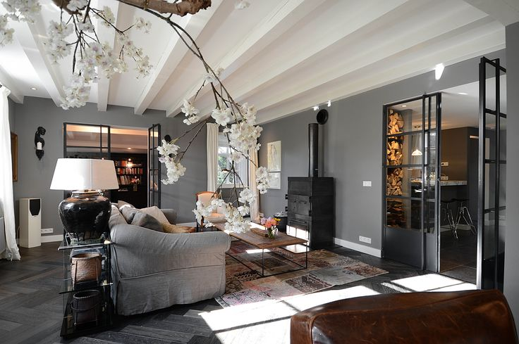 Living room with blossom mineral color flamant patch work carpet ftwl and steel doors - Eigentijdse pouf ...