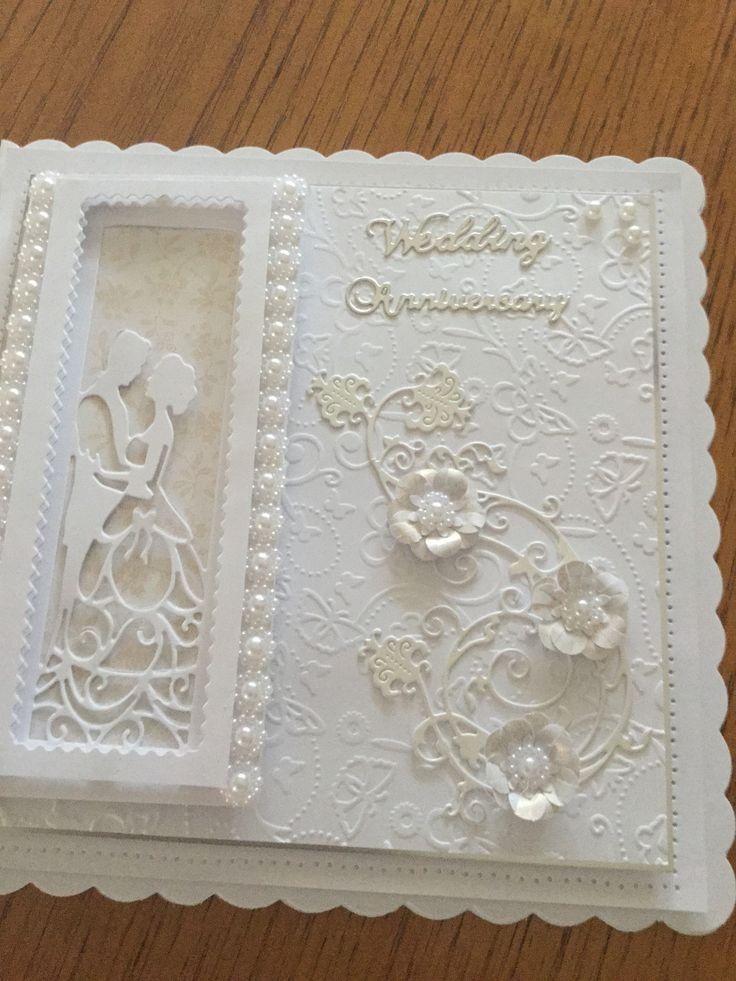 "Made by Christine Jarvis - ""I used the Tonic First Crush die and an embossing folder. I also used a Tattered Lace Flourish die which was free on the magazine and embellished it with strips of pearls and punched flowers for my Daughter's wedding anniversary."" #tonic #tonicstudios #anniversarycard"