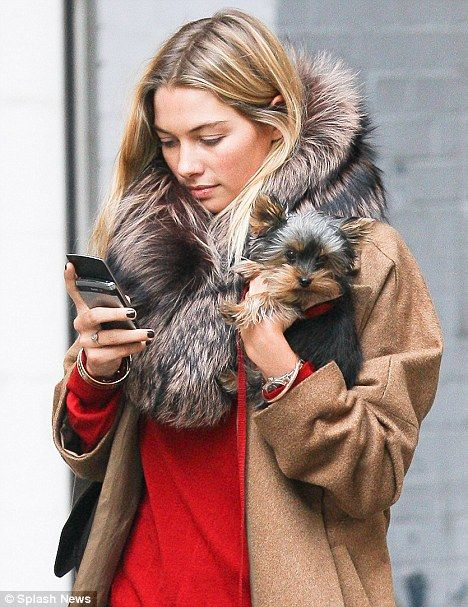 Jessica Hart stepped out with not one, but two fuzzy accessories today