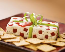 r at least 3 hours. Before serving time, set the unwrapped block of cheese on a platter and decorate it with a scallion bow and red pepper polka dots and gift t