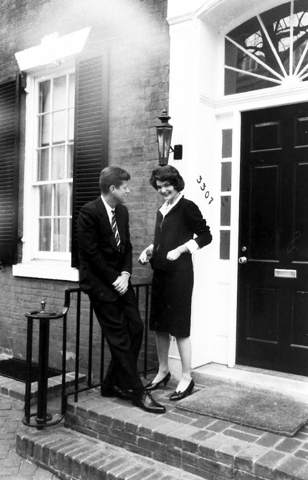 The Kennedy's standing outside their Georgetown home for LIFE Magazine, March 1958.