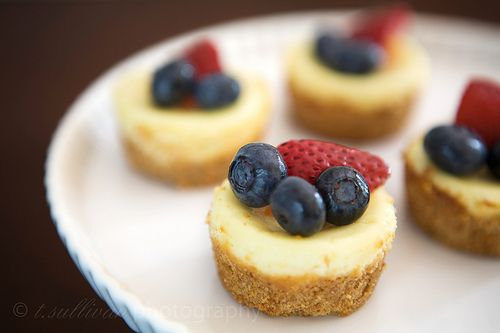 mini cheesecakes topped with fruit - I also made some with drizzled chocolate, too. Very yummy!