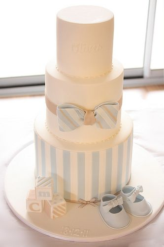 I think the stripes on this cake would look adorable on the bottom tier of the cake with the baby on it.