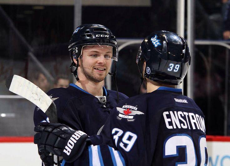 Josh Morrissey and Toby Enstrom of the Winnipeg Jets