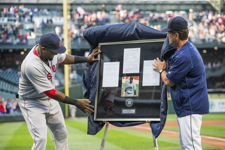 One of the gifts presented to David Ortiz Wednesday was his first major league contract – presented by Edgar Martinez. (Dean Rutz / The Seattle…