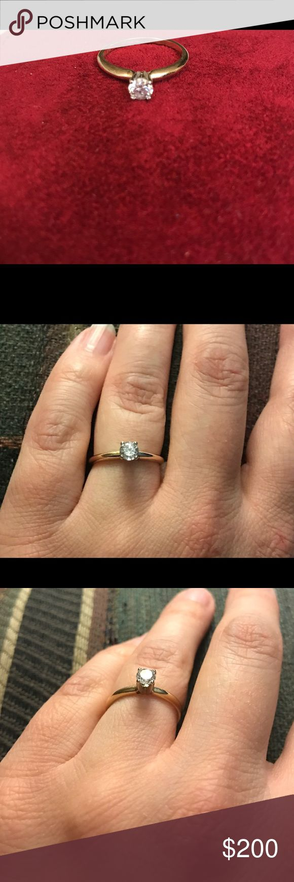 1/3 cttw diamond/ 14k gold engagement ring 1/3 cttw diamond engagement ring.  Marked 14k.  Originally bought at Zales and resized to 4 3/4.  I don't have the paperwork because it's about 20 years old.  It's small so it would make a nice promise ring.  In excellent condition, almost looks new. Zales Jewelry Rings