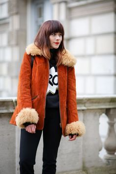 70 Style Lessons From The Streets Of London #refinery29  http://www.refinery29.com/2015/02/82710/london-fashion-week-2015-street-style#slide-17  Suede and shearling doesn't have to feel dated. Pair a cool topper like this one over a graphic T-shirt for extra oomph.