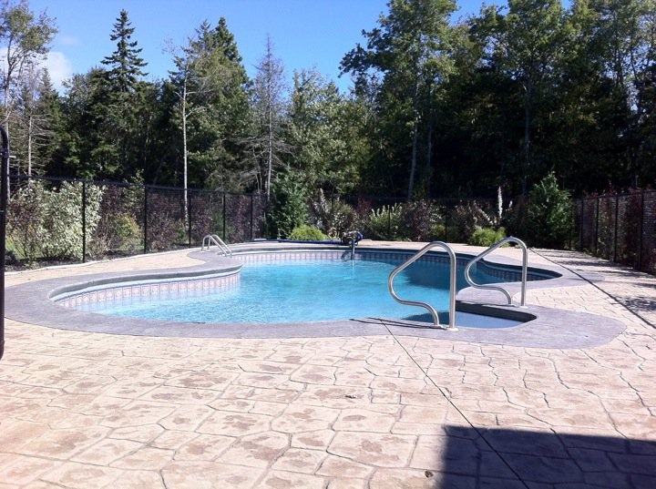 Fiberglass pool remodel stamped concrete and tile around for Concrete inground pools