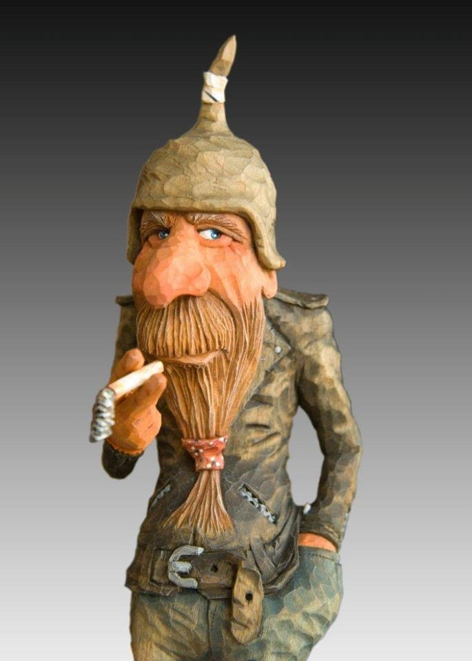 Neatly detailed caricature carving woodcarving wood