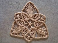 Romanian Point Lace (combination of crocheting and needle weaving). Here is a tutorial for beginners. I was able to make my first RPL project using these instructions from Joanne on her blog Thread Head.