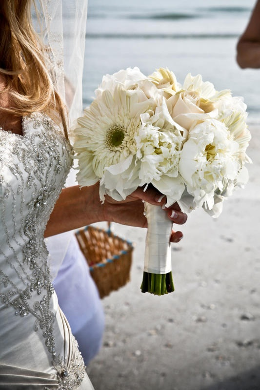 Bridal bouquet of hydrangea, peonies, gerbera daisies and a very few roses.  Colors tones to be soft pink, soft yellow, soft peach and ivory.  Curly willow lightly woven in the floral.