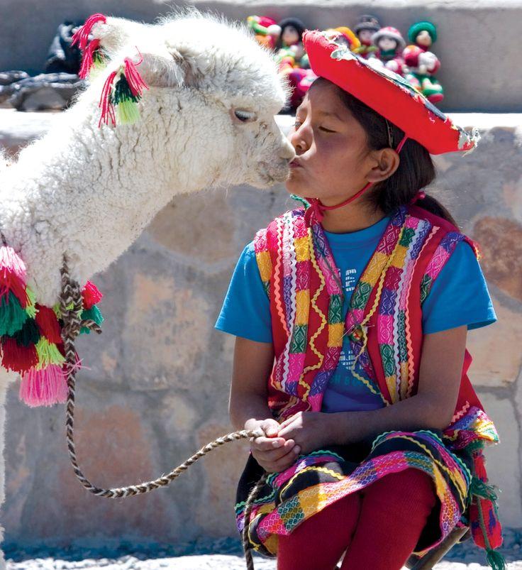 An alpaca kiss in Peru.: