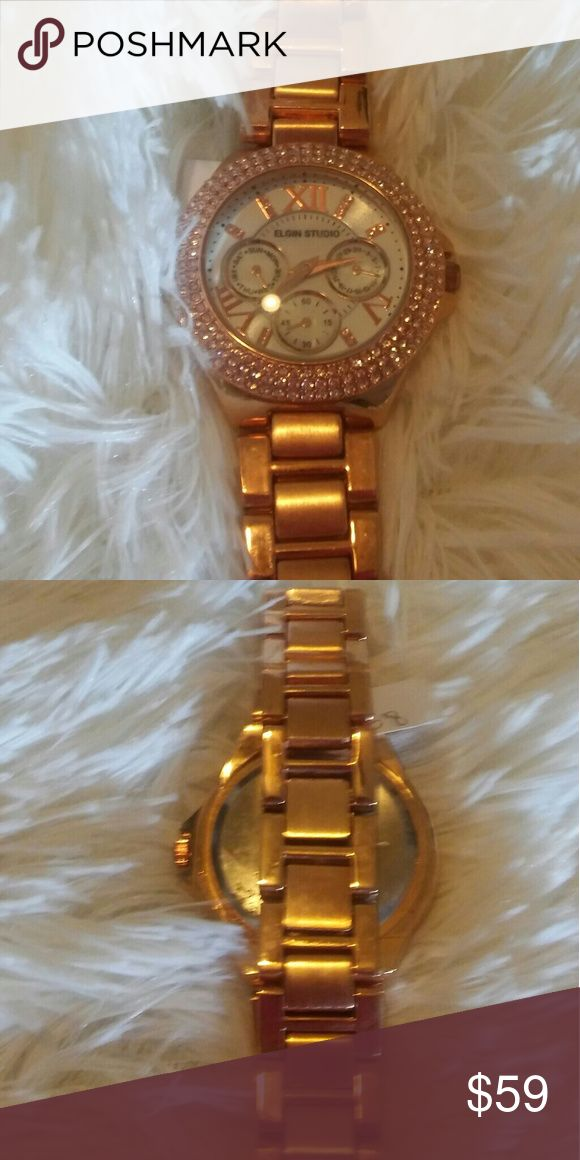 Men's Rose Gold Rhinestone Studded Watch Elgin Studio Quartz Rose gold watch with clasp. Roman Numeral Dial with over 100 shiny rhinestones.  Men's stunning timepiece!!! Elgin Studio Accessories Jewelry