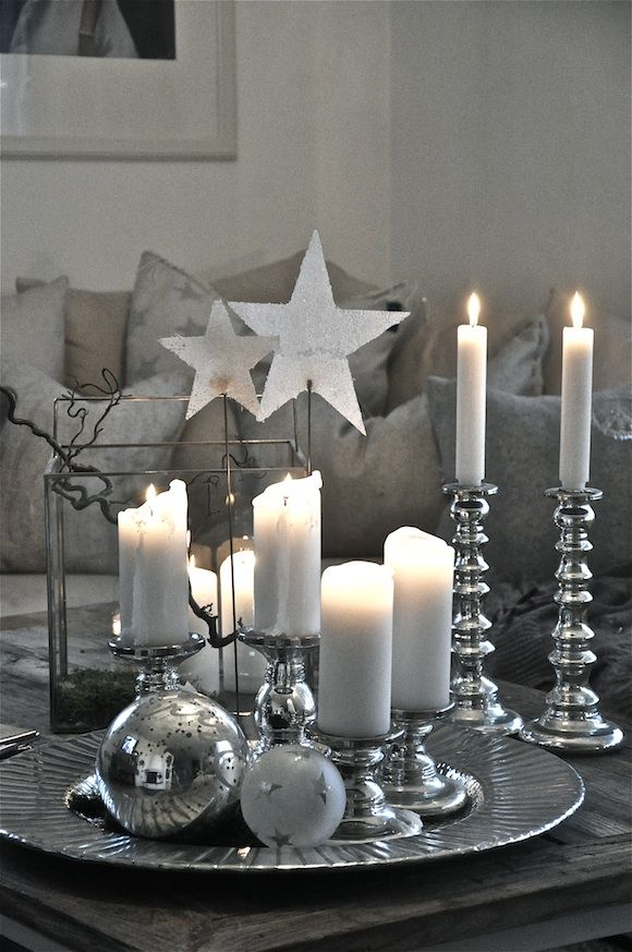 white candles in shining silver