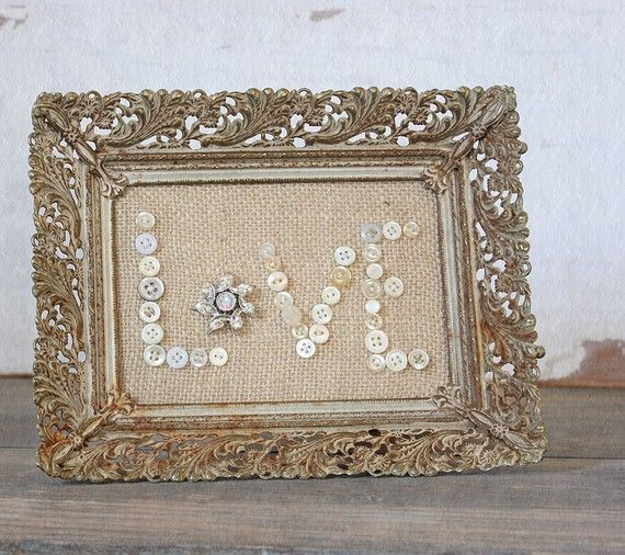I think I could make this by replacing the bottom of my vintage tray with burlap (and the buttons sewn on)  then by gluing a frame on the back to stand it up.....I gotta try!