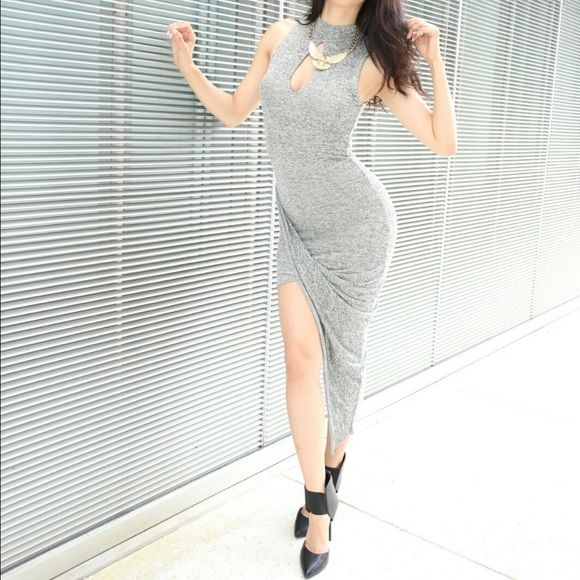 Skin tight dress with slit Skin tight dress with slit. Super sexy. Stretchy. Fits perfectly on any body type. Only worn once. #likenew Dresses Midi